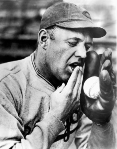 UNDATED:  Burleigh Grimes of the Brooklyn Dodgers demonstrates his spitball before a season game. Burleigh Grimes played for the Brooklyn Dodgers from 1918-1926. (Photo by National Baseball Hall of Fame Library/MLB Photos via Getty Images)